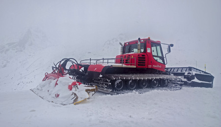 val: Val Thorens, France -  January  16, 2015: Showing the side of a piste bully at Val Thorens Ski Resort. Editorial