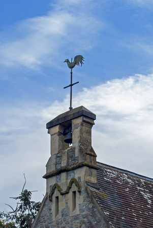 gust: Bell tower with a weathervane dial on the top Stock Photo