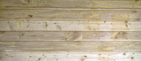 Wood slats and planks in a barn building in Devon UK, showing the grain and rough cut surface,