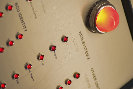 presure: Alarm panel in an industrial building, some with colours removed apart from the alarm lights, Stock Photo