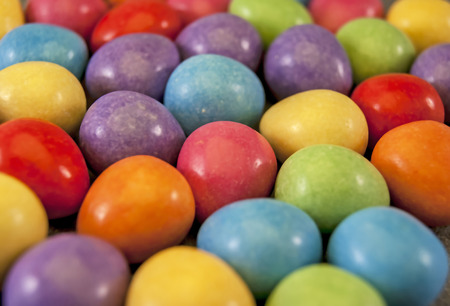 median: Illustration of easter mini eggs laying on a slate table, created using median noise reduction,