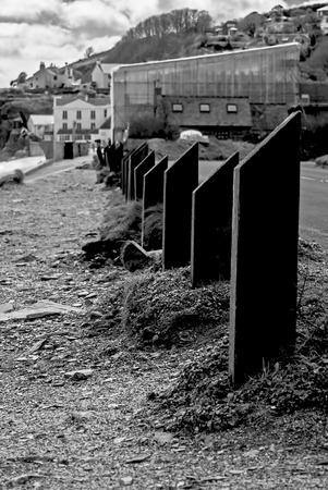 and the stakes: Stakes on a beach in devon uk