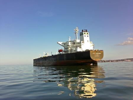 buisiness: Torquay coast, Torquay, Devon, UK, May 22 2012, Showing a cargo ship of the coast of torquay. Editorial