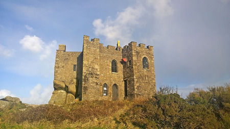 millitary: Red Redruth, Cornwall, UK -  September 2, 2014: Showing the Carn Brea Castle on top of a hill by Redruth