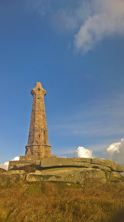 columb: Red Redruth, Cornwall, UK -  September 2, 2014: Showing the Carn Brea Cross on top of a hill by Redruth