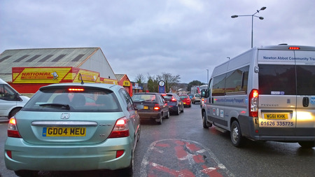 gridlock: Newton abbot, Devon, UK - February 25 2015, Showing a traffic jam over a roundabout in the morning rush hour traffic during a time that road works were ongoing on most of the exit and entry roads into the town Editorial