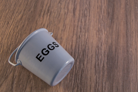 nautral: Egg cups shown lying on a wooden