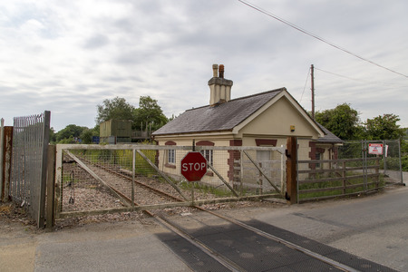 abbot: Newton abbot Devon UK 11 JUNE 2015  Showing an old level railway crossing with an building next to it