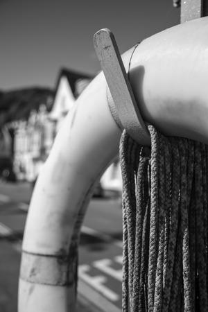 gaurd: Life saving bouyency ring hanging on a pole
