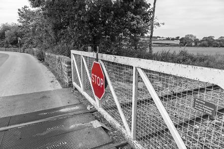 joins: Newton abbot Devon UK 11 JUNE 2015  Showing an unrecognisable railway level crossing gate.