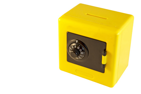 Plastic yellow safe isolated on a white  Stock Photo