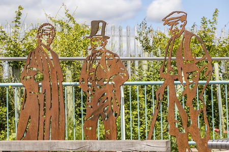 abbot: Newton abbot Devon UK 3 JUNE 2015  Showing steel sculptures of Isambard Kingdom Brunel in the middle who brought the South Devon Railway to Newton Abbot in 1846 Dr Ivy Williams who was born in Newton Abbot and became Englands first female barrister in 1