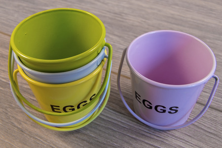 egg cups: Egg cups shown lying on a wooden