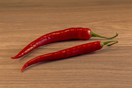 shown: Red Chillies shown lying on a wooden