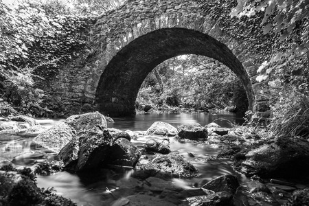 circular water ripple: Stone Bridge with a river running beneath