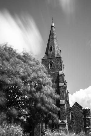 devon: Modbury, Devon, England, UK - Showing Modbury church in the centre of the village of Modbury in south devon UK, Stock Photo