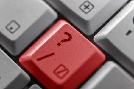 buisiness: Showing a question mark button on a computer keyboard Stock Photo