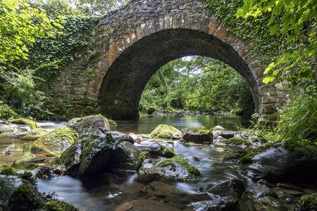 beneath: Stone Bridge with a river running beneath