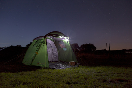 stary: Showing a tent in a camping field with a stary sky in the background.