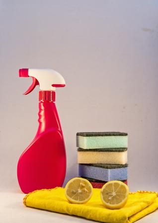 Bottle, sponge and lemon