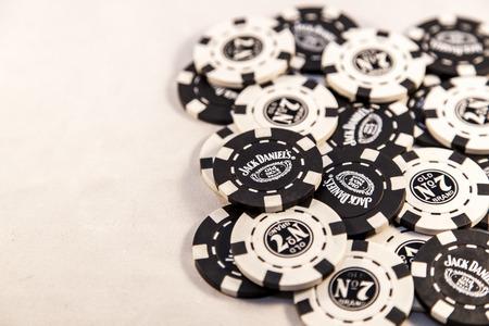 daniels: Newton abbot, Devon, UK, SEPTEMBER 9 2015 - Showing Jack Daniels brand poker chips laying on a white background. Stock Photo