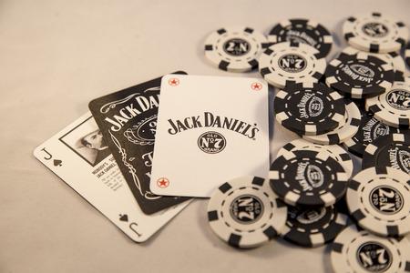daniels: Newton abbot, Devon, UK, SEPTEMBER 9 2015 - Showing Jack Daniels brand poker chips laying on a white background. Editorial