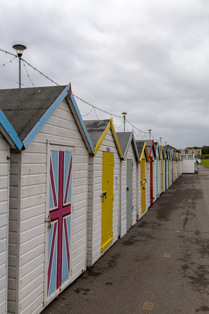 pitched: Paignton, Devon, UK, JULY 8 2015 - Showing beach huts on the Paignton seafront Editorial