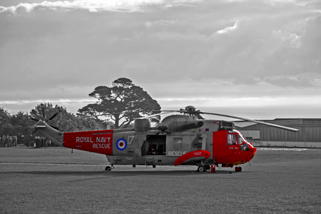 raf: Teignmouth, Devon, UK 9 October 2015 - Showing a british red and grey royal navy MK5 Seaking RAF search and rescue helicopter