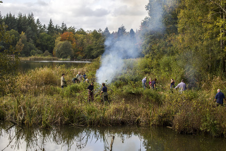 abbot: Stover, Newton abbot, Devon UK November 25 2015 - Showing a working party completing enviromental conservation by burning old organic rubbush at Stover nature reserve, Editorial