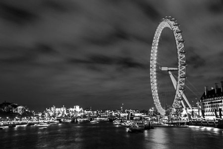 city of westminster: Westminster, London, UK, December 16 2015 - Showing a City scape looking accross from Westminster bridge, with the London eye visable in on the right hand side, taken at night during a lond exposure, Cityscape utilising Freedom of Panorama