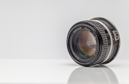 abbot: Newton abbot, Devon, UK, March 16th 2016  - Showing a old used Nikon Nikor AIs f1.4 metal lens from the 1980s isolated on a white background
