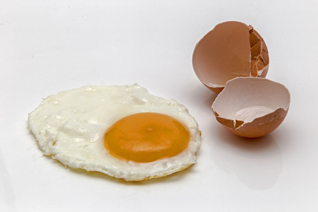 cheff: Showing a cooked egg isolated on a white background with an egg shell