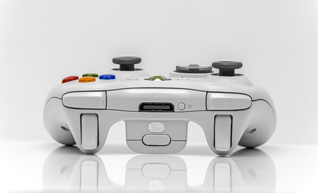 bottons: Newton abbot, Devon, UK, March 16th 2016  - Showing a Microsoft xbox360 games console controller isolated on a white background