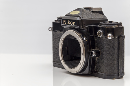 abbot: Newton abbot, Devon, UK, March 18th 2016  - Showing a Nikon FE 1980s analog film body camera without a lens fitted and isolated on a white background