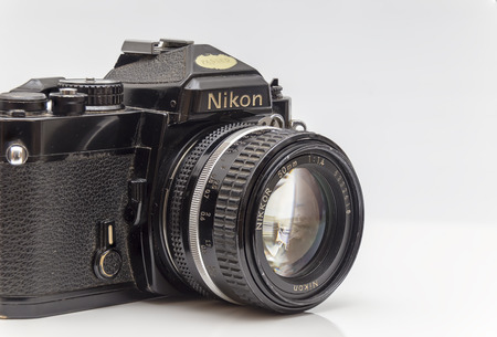 abbot: Newton abbot, Devon, UK, March 18th 2016  - Showing a Nikon FE 1980s analog film camera with a Nikon Nikor f1.4 lens fitted and isolated on a white background