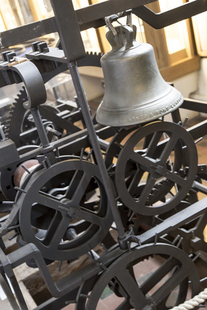 St Albans, London, UK, March 31st 2016 - Showing the Wallingford sun dial, bell and gears of the wallingford clock from the 14th century, sat in place at St Albans Cathedral. The clock could predict lunar eclispes as well as telling the time