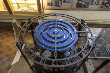 wallingford: St Albans, London, UK, March 31st 2016 - Showing the Wallingford sun dial, bell and gears of the wallingford clock from the 14th century, sat in place at St Albans Cathedral. The clock could predict lunar eclispes as well as telling the time Editorial