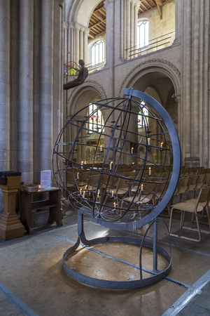 columb: Norwich, Northfolk, UK, March 30th 2016 - Showing a round candle lit globe at Norwich Cathedral catholic church, Showing the interior of the church with one of its grand halls Editorial