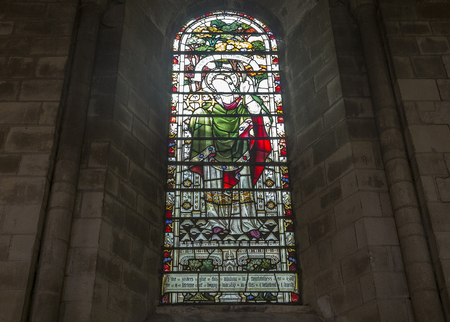 columb: Norwich, Northfolk, UK, March 30th 2016 - Showing a stained glass windows at the Norwich Cathedral catholic church, Showing the interior of the church which one of its grand halls Editorial