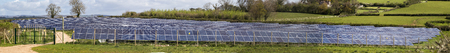 pv: Newton abbot, Devon, UK,  May 3 2016 - Showing a multi image stich and panarama of a solar electricity PV farm in Denbury, created to supply renewable green energy to the area of Newton abbot.
