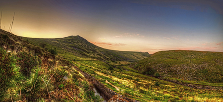 cleave: Showing the entrance to Tavy Cleave valley a very remote location on dartmoor in South Devon, not far from Peter Tavy and Tavistock, With Sharptor shown on the righthand side in the distance Stock Photo