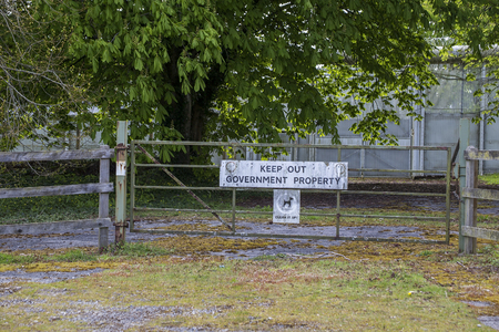 abbot: Denbury, Newton abbot, Devon, UK,  May 3 2016 - Showing a sign on the gateway of goverment property leading to Channings wood prision, with a message saying keep out, beside a country lane in the village of denbury