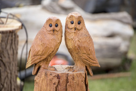 Wadebridge, Cornwall, UK, June 11 2016 -Showing a carved owl made from a tree trunk, on display at a forestry demonstraion at an agricultural show Editorial