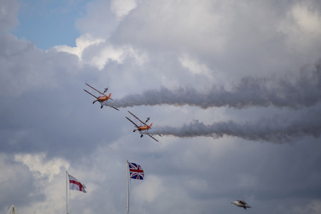 Torquay, Devon, UK, 12 June 2016 Showing various planes at the air display at the Torquay airshow, shot from public land during an overcast day Editorial