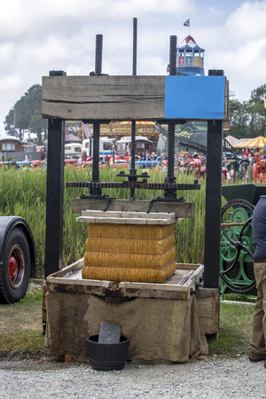pulp: Wadebridge, Cornwall, UK, June 11 2016 - Showing a old fashioned cider press, squashing a compressed apple pulp Editorial