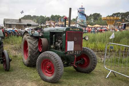 massy: Wadebridge, Cornwall, UK, June 11 2016 - Showing an old retro Oliver agricultural tractor at a classice tractor show