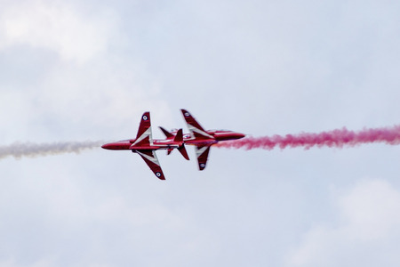 achivement: Torquay, Devon, UK, 12 June 2016 Showing the various formations of the RAF Red Arrows air display at the Torquay airshow, shot from public land during an overcast day