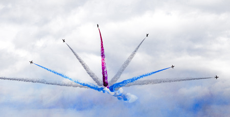 raf: Torquay, Devon, UK, 12 June 2016 Showing the various formations of the RAF Red Arrows air display at the Torquay airshow, shot from public land during an overcast day