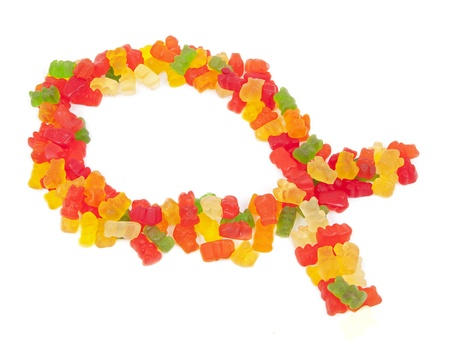 gospels: An Ichthys, or Jesus Fish, made of candy against a white background