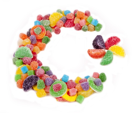 A color star and crescent moon made of candy against a white background
